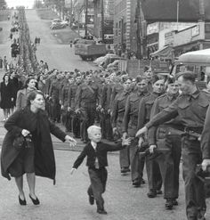 Claude D DetloffWarren Bernard reaches for his father's hand in New Westminster, Canada, 1940.