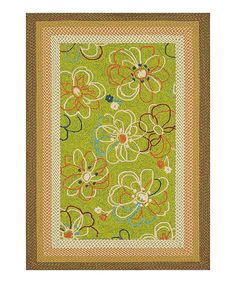 Beautiful hand-braided trim Indoor/Outdoor floral rug.