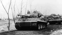 Tiger tanks from the 13./SS-Panzer-Regiment 1 of the Leibstandarte Division roll out on a mission west of Kiev in late 1943.