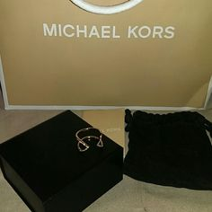 Michael Kors Ring MK rose gold ring. Comes with original box, velvet bag and booklet. There are two missing jewels as pictured. Not sure if these can be replaced at the store. Michael Kors Jewelry Rings