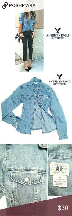 "AMERICAN EAGLE OUTFITTERS FITTED DENIM SHIRT AMERICAN EAGLE OUTFITTERS  FITTED DENIM LONG SLEEVE  SHIRT Pre-Loved  / EUC RN# 54885 Size M 100% Cotton Very Cool Denim Fitted Shirt w/ Front Pockets & White Buttons Approx Meas;    *   Armpit to Armpit   19""    *   Back Collar to Hem L   24""    *   Arm Length   20"" Beautiful! Please See All Pics. Ask ? If Not Sure; American Eagle Outfitters Tops Button Down Shirts"