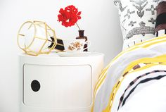 Work Lamp in gold by Form Us With Love for Design House Stockholm. Night stand from Kartell.