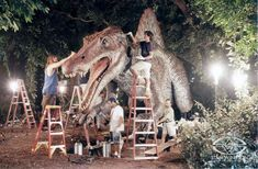 The Stan Winston Studio crew adds the final details to the massive Spinosaurus animatronic on the set of JURASSIC PARK III.