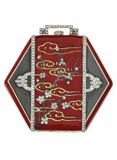 VAN CLEEF & ARPELS - AN ART DECO ENAMEL AND DIAMOND COMPACT, 1930S. Of hexagonal Japanese style, the red enamel central panel with gold cloud designs and black enamel tree applied with small diamond flowers, to the black enamel shoulder panels, with diamond line borders and applied diamond-set geometric design, with diamond-set push-piece and handle, opening to reveal a mirror and a powder compartment, 5.5 cm, with French assay marks for platinum and gold, signed Van Cleef & Arpels.