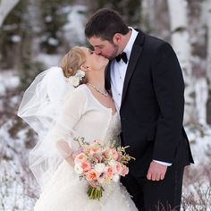 Real Wedding—couple kisses in the snow in Jackson Hole, Wyoming