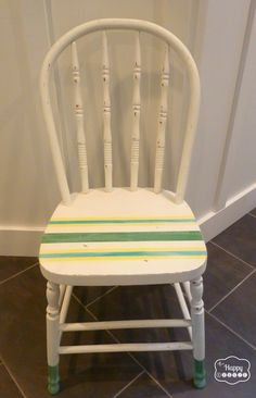 Painted distressed chair with dipped looking legs and painted stripes using DIY chalk paint as the base and craft paint for the stripes full tutorial at thehappyhousie
