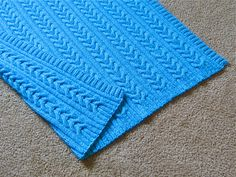 """Ravelry: """"Splash"""" Reversible Cables Baby Blanket pattern by Amy Andersen"""
