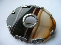 victorian silver and scottish banded agate brooch...love the prongs!
