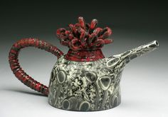 Marcy a Neiditz - Red Loopy Teapot. black stain over a glaze and re-fired.