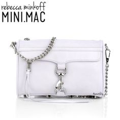 "REBECCA MINKOFF mini mac crossbody NEW with tags, never used and in excellent condition. leather is slightly off white (not a bright white) w/ a hint of lavender & silver hardware. detachable chain strap to use as a clutch. extra leather zipper pulls, dust bag, and care card included.  height- 6"" length- 9"" width- 1.25"" strap- 44"" / 21"" drop  please don't hesitate to ask questions. happy POSHing    use offer feature to negotiate price on single item  i do not trade or take any transactions…"