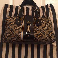 LAMB Handbag LAMB handbag in excellent condition. Classic LAMB canvas with black trim and handles. Gold tone hardware and zip closure. Inside zip pocket. Comes with storage bag. ❤️ L.A.M.B. Bags