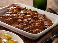 Alton's Pot Roast: Alton modernizes traditional pot roast by seasoning the beef with cumin and cooking it with tangy balsamic vinegar, olives and raisins. #RecipeOfTheDay