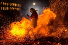 """The Explosion. Photograph by Hidetoshi Ogata - The fire festival called """"Yassai-Hossai"""" is founded on a fact that fisherman helped their god """"Ebisu"""" who was drifted on Iwatsuta Shrine. They warmed Ebisu by burning of one hundred eight pieces of fire wood bundles"""