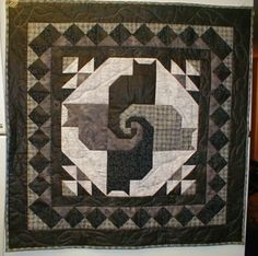 """Swirling cats. from: Elisa Hernandez Lawrance: """"This is the Snail pattern and was a mystery class...I loved the end result because I have a black cat, Monty!"""""""