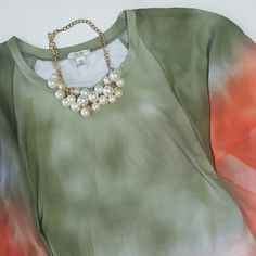Cache top with sheer batwing sleeves This top is beautiful! Olive and orange blended. Top is a soft polyester/spandex blend with sheer batwing sleeves. Could easily be dressed up or worn casually with jeans. Like new condition. No stains, tears, or piling. Size xs but would fit small as well. Cache Tops