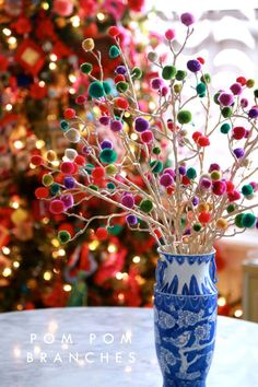 Lighten up your Christmas tree by adding DIY pom pom branches to the edges. Christmas decor inspiration. Please choose cruelty free materials and supplies, go vegan!