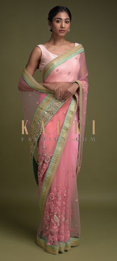 Buy Online from the link below. We ship worldwide (Free Shipping over US$100)  Click Anywhere to Tag  Rose Pink Saree In Net Adorned With Thread And Zardozi Embroidered Floral Pattern Online - Kalki Fashion  Rose pink saree in net adorned with green zari embroidered border.Further enhanced with thread, zardozi and sequins embroidered border buttis.
