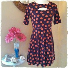 HP!! Fit & Flare Plum polka dot small dress Never worn, polyester dress with small cutout above chest. Fun and comfortable summer dress. NWT. Flawless! DISCOUNTED BUNDLES AND SHIPPING! FREE STATEMENT NECKLACE WITH $50 PURCHASE! Xhilaration Dresses