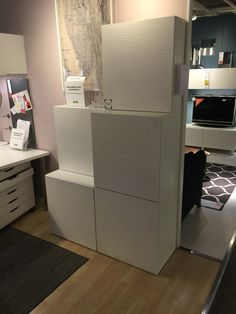 Made from Ikea Besta Units with the Laxviken Doors, which are a modern white texture