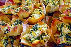 Spinach Dip Wonton Cups   could also use puff pastry squares  and fill those    http://hostthetoast.com