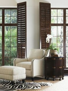 British Colonial feeling with  the inside dark louvered  shutters