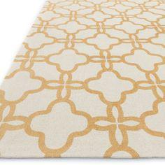 Yellow quatrefoil area rug.