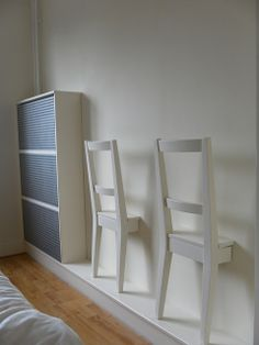 "LOVE this! These IKEA chairs were cut off and attached to a bedroom wall... Art and function... created to use as a ""valet"" for men to hang pants, jackets, etc. for the following day but would work for a woman or kid as well. CLEVER!"