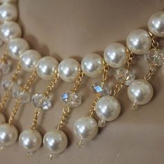 Large 14mm ivory mother of pearl and 12mm clear crystal beads dangle with gold plated chain from more beaded pearls forming this fabulous bib necklace. With a lovely leaf hook clasp this necklace meas