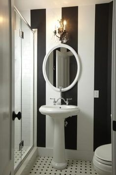 This black and white bathroom wallpaper with its bold lines, makes the room look more spacious. It is such a classy design. - The Design Gourmet - Striped Bathroom Walls, Striped Walls, White Walls, Black White Bathrooms, Black And White Tiles, Bathroom Black, White Marble, Bathroom Design Small, Bath Design