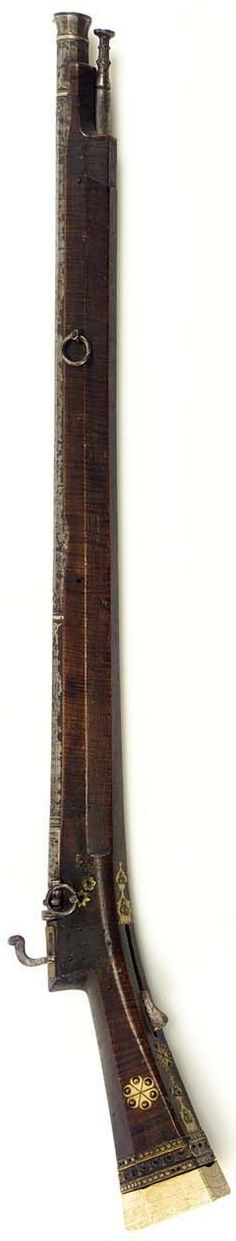 Ottoman matchlock heavy gun, late 17th century, the facetted barrel wrought with flaring muzzle, profusely inlaid in silver, full length hardwood stock inlaid in ivory with 'eyes' grouped in three, buttcaps detached, with massive ramrod, length overall 142cm.