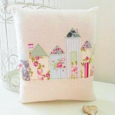 pretty pillow with street of houses appliques