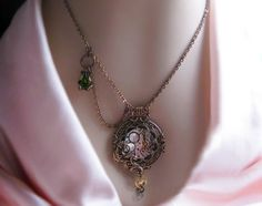 Steampunk necklace Victorian pocket watch style pendant with swag chain, steampunk jewelry, statement necklace. $105.00, via Etsy.