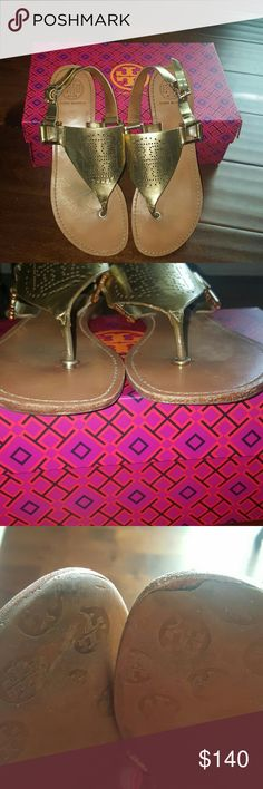 JUST IN TORY BURCH PERFORATED SANDALS Authentic gold Tory Burch perforated sandals. Sandals have been worn but still have life left in them. Some staining on the footbed as shown in final photo. Stains are within the small folds from walking in the shoe. Also, small wear on the bottom top part of the sandals as shown in 3rd photo. 100 % not visible when worn or looking at them from the front as shown in 2nd photo. Minor wear and tear but overall beautiful sandals. OPEN TO ALL OFFERS! BOX NOT…