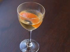 1 1/2 ounces white rum     3/4 ounce dry vermouth     3/4 ounce orange curacao     1 dash grenadine     Garnish: orange twist  Procedures      1      Pour all ingredients into a mixing glass and fill with ice. Stir briskly for 30 seconds, and strain into a chilled cocktail glass. Twist a piece of orange peel over the drink and use as garnish.