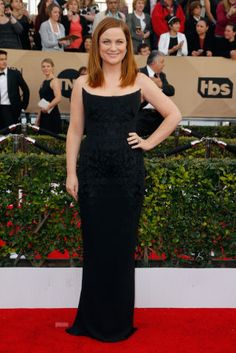 Amy Poehler in a Stella McCartney dress and Brian Atwood shoes.