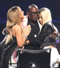 Mariah Carey and Nicki Minaj congratulate Randy Jackson on 12 years as a judge on American Idol. (AP Photo)