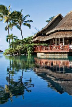 The Laguna Pool is one of the resort's two pools with views of the azure waters beyond. Constance Le Prince Maurice (Mauritius) - Jetsetter