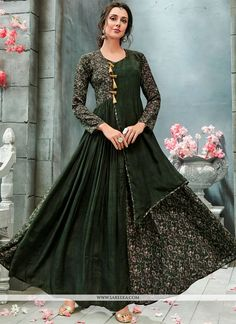 Unique elegance can come out through the dressing design with this green faux georgette readymade gown . The lovely print work throughout the attire is awe inspiring. (Slight variation in color, fabri...