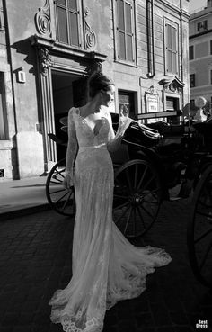 Lace wedding gown with sleeves by Inbal Dror