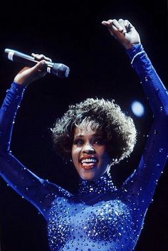 Whitney Houston ... throw your hands up wears Marc Bouwer beaded catsuit
