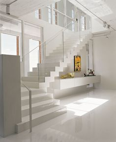the stairs in the white and yellow loft ...