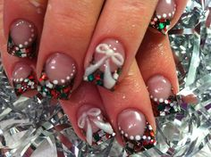 Ribbon inspired Christmas nail art design. Fill your nails with embellishments such as colorful sequins and ribbons to make it look real stunning and out there.