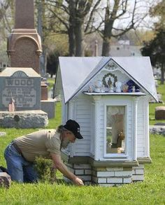 A dollhouse in place of a grave stone for a young girl who passed in 1899.