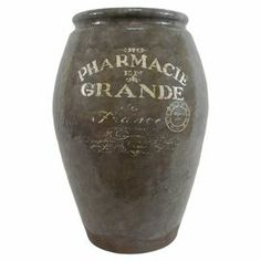 """Terracotta urn with a French text motif   Product: UrnConstruction Material: TerracottaColor: BrownDimensions: 20"""" H x 13"""" Diameter"""