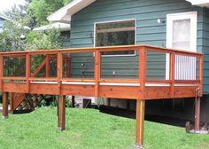Decks Railings with Tempered Glass See plenty Deck Railing Ideas http://awoodrailing.com/2014/11/16/100s-of-deck-railing-ideas-designs/