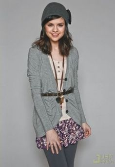 I don't care if it is who it is.. I love this idea. shorter skirt with leggings (help make legs look longer?) cardigan and long necklace to lengthen body but the belt over top to shop the waistline.