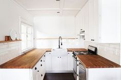 Butcher Block Counters in a White Kitchen