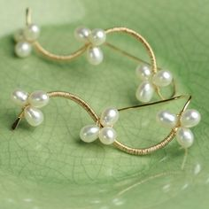 Pearl Vine Earrings White Pearls Gold Fill Wire Wrapped by fussjewelry on Etsy https://www.etsy.com/listing/48090510/pearl-vine-earrings-white-pearls-gold
