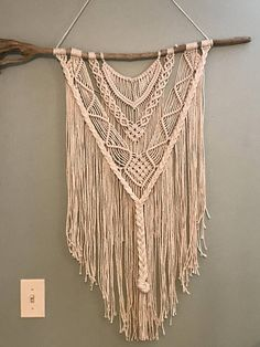 This gorgeous modern wall hanging will add beauty and style to any space in your home. *It hangs on a long piece of driftwood and can be cut to any length. Just send me a private message. *This can also be made in a smaller size. *All pieces are made to order.