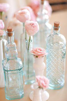Let the vessel speak for itself — display simple roses in vintage bottles.